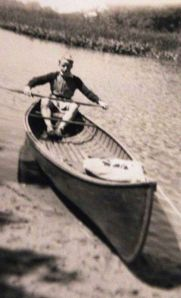 In his canoe.
