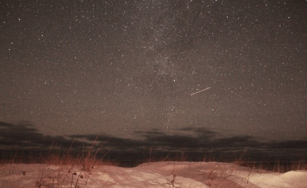 Low dunes, clouds on the horizon and maybe a plane.  Oh..and stars.