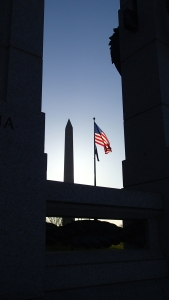 WW II, Washington Monument and Flag in morning light.