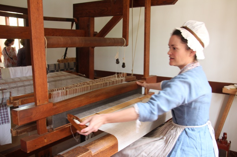 Explaining how the loom works.