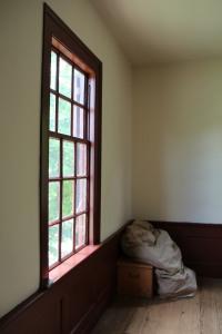 Bedroll stored in a corner