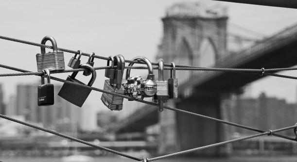 Locks on a pier in Brooklyn NY, near the Brooklyn Bridge.
