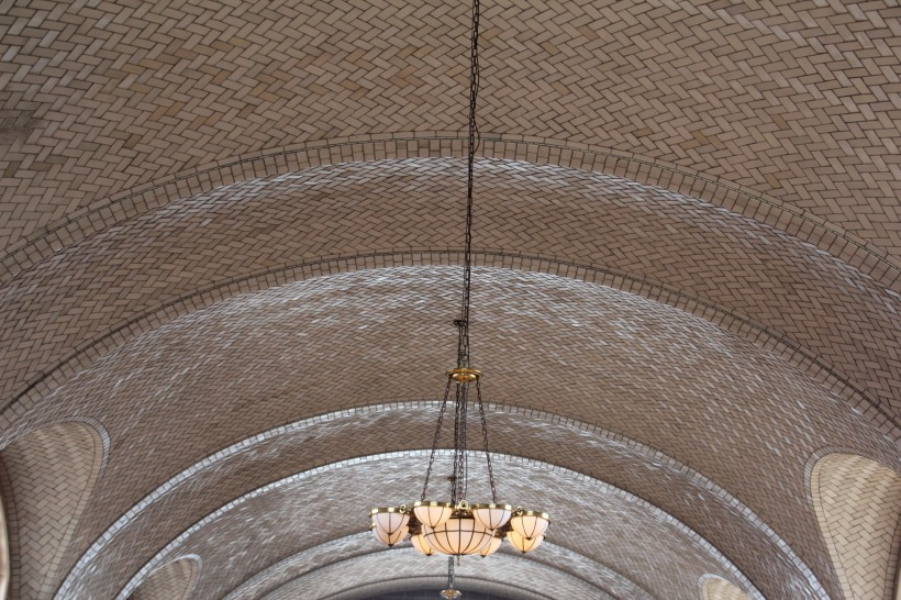 Notice the beautiful tiled arches.  And the original fixture.