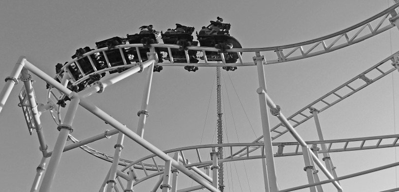 Humans ride through the air on a man made roller coaster.